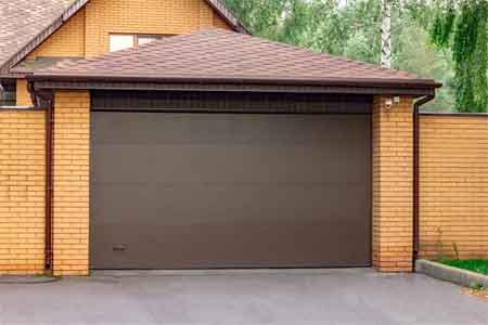 How to replace garage door rollers without bending track