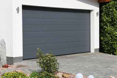Steps to replace garage door rollers without bending track